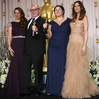 Maya Rudolph, Terry George, Oorlagh George, Kristen Wiig in 84th Annual Academy Awards - Press Room