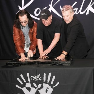 Rush in Rush Honored on Guitar Center's RockWalk