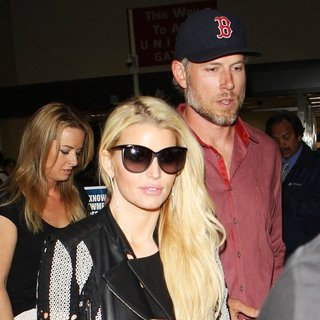 Jessica Simpson Arrives at Los Angeles International Airport with Eric Johnson