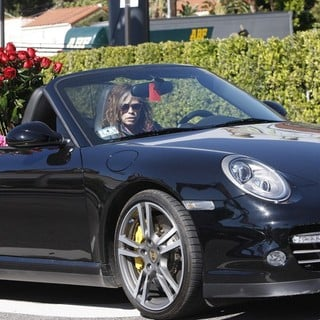 Steven Tyler in Steven Tyler Seen Driving in Los Angeles with A Bouquet of Flowers