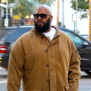 Suge Knight in Suge Knight Sighted Smoking A Cigar Walking on Wilshire Boulevard