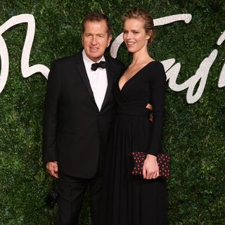 Mario Testino, Eva Herzigova in The British Fashion Awards 2014 - Arrivals
