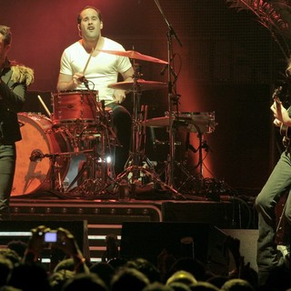 Brandon Flowers, Ronnie Vannucci, Jr., Mark Stoermer, The Killers in The Killers Performing at The American Airlines Arena