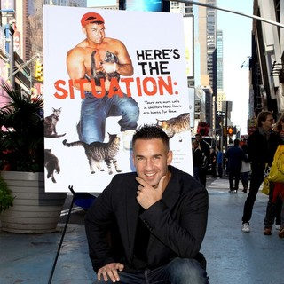 The Situation in The Situation Attends A Photocall in Times Square for PETA's Ad Campaign