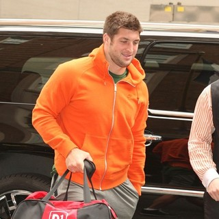 Tim Tebow - Tim Tebow Arriving at His Hotel in An Orange Hoodie