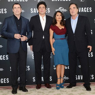 John Travolta in Savages Photocall - travolta-toro-hayek-stone-photocall-savages-01