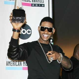 Usher in The 40th Anniversary American Music Awards - Press Room - usher-40th-anniversary-american-music-awards-press-room-02