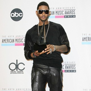Usher in The 40th Anniversary American Music Awards - Press Room
