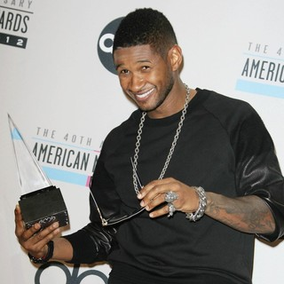 Usher in The 40th Anniversary American Music Awards - Press Room - usher-40th-anniversary-american-music-awards-press-room-06