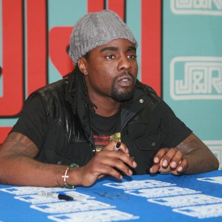 Wale in Wale Signs Copies of His Album Ambition