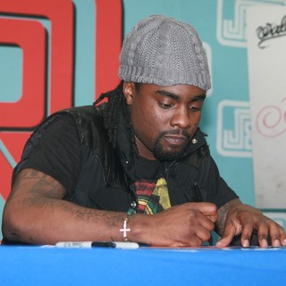 Wale Signs Copies of His Album Ambition