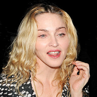 Madonna is all smiles as she arrives at Cecconi's restaurant in Mayfair with her bodyguard