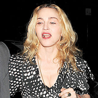 Madonna - Madonna is all smiles as she arrives at Cecconi's restaurant in Mayfair with her bodyguard