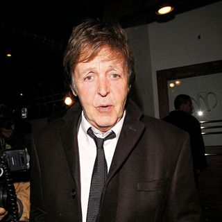 Paul McCartney - Paul McCartney Is Surrounded by Photographers as He Leaves Madeos Restaurant