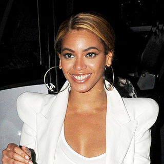 Beyonce Knowles - Beyonce Knowles wears a white jacket with huge shoulder pads for a night out