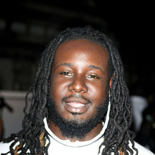 T-Pain in The Miami Dolphins Cheerleaders 2010 Swimsuit Calendar unveiling and their annual swimwear fashion