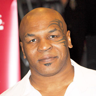 Mike Tyson in Mike Tyson signing copies of the Blu-ray and DVD 'Tyson'