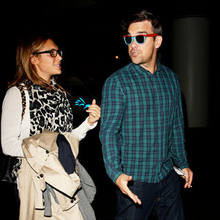 Ayda Field, Robbie Williams in Robbie Williams with His Blue Suede Shoes and Blue Checked Shirt Arrives in LA with Ayda Field