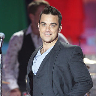 Robbie Williams in Robbie Williams Performing During Miss France 2010