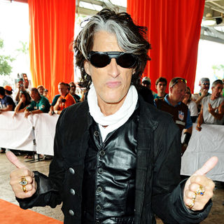 Joe Perry in Joe Perry arrives at the Orange Carpet before Miami Dolphins vs New England Patriots football game
