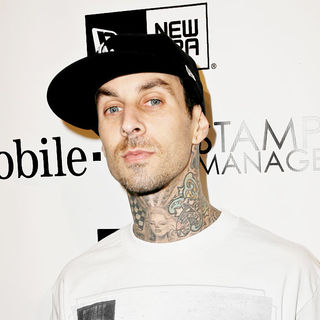Travis Barker in the famous stars & straps 10th anniversary and Snoop Dog's 10th Studio Album celebrations