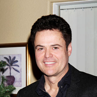 Donny Osmond in Donny and Marie Osmond deliver food to senior citizens