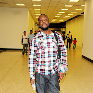 Wyclef Jean in Wyclef Jean leaves Miami International Airport flying home to Haiti for Christmas