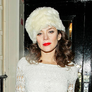 Anna Friel in Anna Friel leaves the Royal Haymarket Theatre in a white fur hat and wearing a white crochet dress