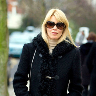 Claudia Schiffer in Claudia Schiffer making her way home after dropping her children at school