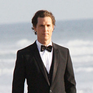 Matthew McConaughey dressed in a tuxedo for a photo shoot on Zuma Beach