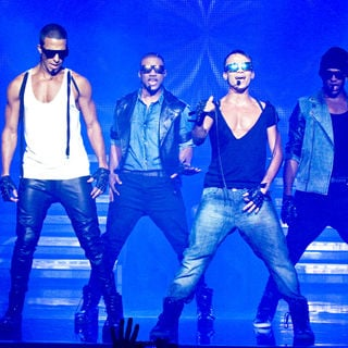 JLS performimg live on stage