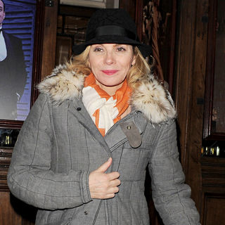 Kim Cattrall in Kim Cattrall is all smiles as she leaves the Vaudeville Theatre via the front door