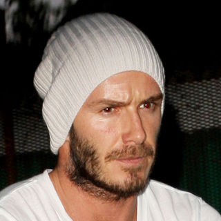 David Beckham in David Beckham Showing Facial Scar from being Injured During The Serie A Match with Chievo