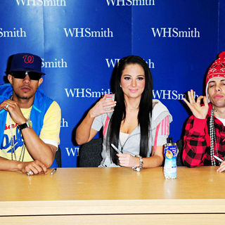 N-Dubz in N-Dubz sign copies of their book 'N-Dubz: Against All Odds'