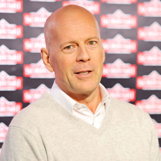 Bruce Willis Prepares A Cocktail During A Press Conference to Promote Sobieski Vodka - wenn2901820