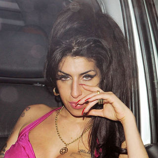 Amy Winehouse Enjoys A Night Out with Friends