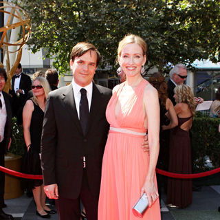 Marcelo Zarvos, Janel Moloney in 2010 Creative Arts Emmy Awards - Arrivals