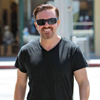 Ricky Gervais in Ricky Gervais Shopping at Radio Shack Dressed in Black T-Shirt and Trousers