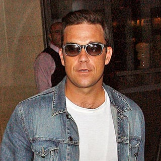 Robbie Williams in Robbie Williams Wearing A Denim Jacket and Jeans Leaves His Hotel