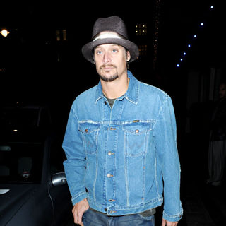 Kid Rock in Kid Rock Out and About Wearing A Denim Jacket and Jeans