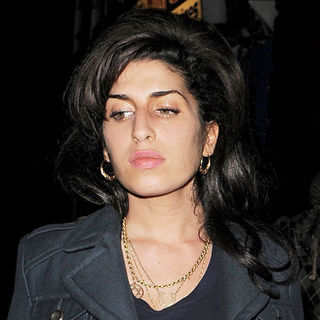 Amy Winehouse in Amy Winehouse Leaving A Secret Charity Gig Called 'Apocalypstick'