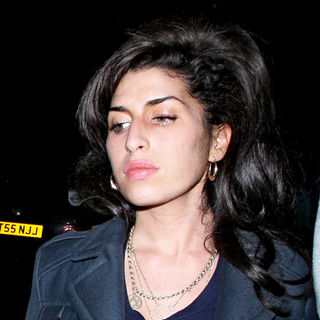 Amy Winehouse Leaving A Secret Charity Gig Called 'Apocalypstick'