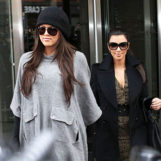 Kim Kardashian - Khloe Kardashian and Kim Kardashian Surrounded by Fans and Photographers as They Leave Their Hotel