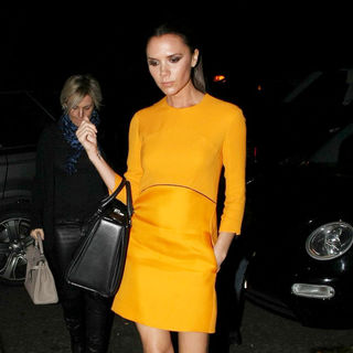 Victoria Adams in Victoria Beckham Arriving at Gordon Ramsay's Maze Restaurant in Mayfair Wearing An Orange Dress