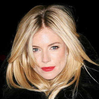 Sienna Miller in Sienna Miller Officially Turns The London Eye Landmark Red to Mark World AIDS Day