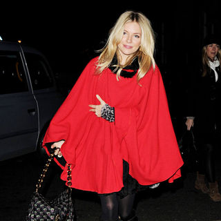 Sienna Miller in Sienna Miller Wearing A Large Red Cape at St. Paul's Church