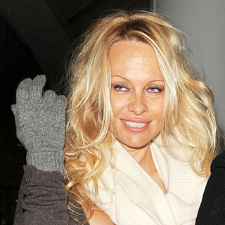 Pamela Anderson in Pamela Anderson Arriving at Heathrow Airport