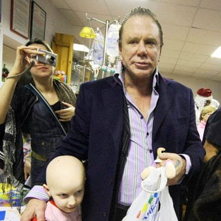 Mickey Rourke Hands Out Gifts During His Visit to A Children's Hospital