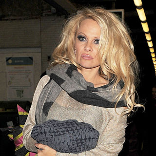 Pamela Anderson in Pamela Anderson Appears to be in A Rather Distressed State, as She Arrives at Euston Station