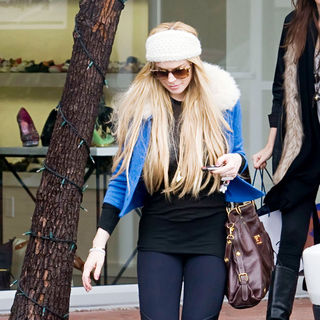 Lindsay Lohan in Lindsay Lohan Goes for Some Retail Therapy at Fred Segal on Melrose Avenue with A Friend
